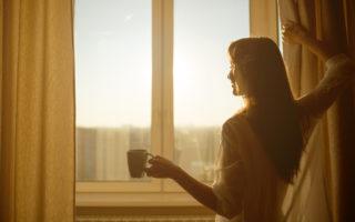 woman waking up smiling on Monday morning